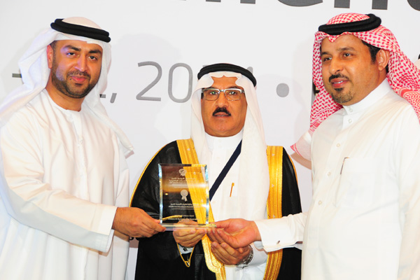 H.E Dr. Eng Ali Mohammad Al-Khouri, Director General of the Emirates Identity Authority (Left) and H.E. Dr. Fahad bin Matad Al-Hamad, Assistant Chairman of the Shura Council (Middle) presenting the eMinistry Excellence Award to the Ministry Of Municipal And Rural Affairs - KSA