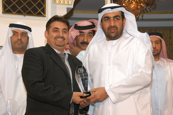 Crystal Arc Monther Ahmed Al Saher Receiving the award