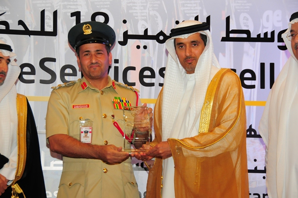 Government Social Media Excellence Award, Dubai police. Award received by Brigadier Mohammed Saeed Bakhit, Director of General Department of eService, Dubai Police. Award presented by H.E Dr Ahmed Saeed Bin Hazim,  Director General of Dubai Courts