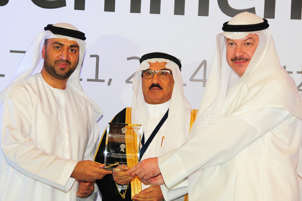 H.E Dr. Eng Ali Mohammad Al-Khouri, Director General of the Emirates Identity Authority (Left) and H.E. Dr. Fahad bin Matad Al-Hamad, Assistant Chairman of the Shura Council (Middle) presenting the eInitiative Excellence Award to The Central Agency For Information Technology - Kuwait