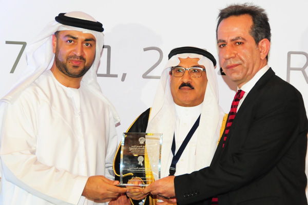 H.E Dr. Eng Ali Mohammad Al-Khouri, Director General of the Emirates Identity Authority (Left) and H.E. Dr. Fahad bin Matad Al-Hamad, Assistant Chairman of the Shura Council (Middle) presenting the eEducation Excellence Award Einitiative to the Abu Dhabi Education Council (Adec)