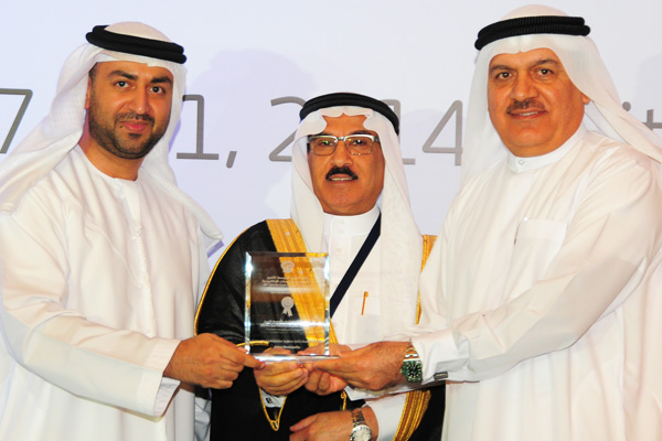 H.E Dr. Eng Ali Mohammad Al-Khouri, Director General of the Emirates Identity Authority (Left) and H.E. Dr. Fahad bin Matad Al-Hamad, Assistant Chairman of the Shura Council (Middle) presenting the Geographical Information Systems (GIS) Excellence Award to the Dubai Municipality