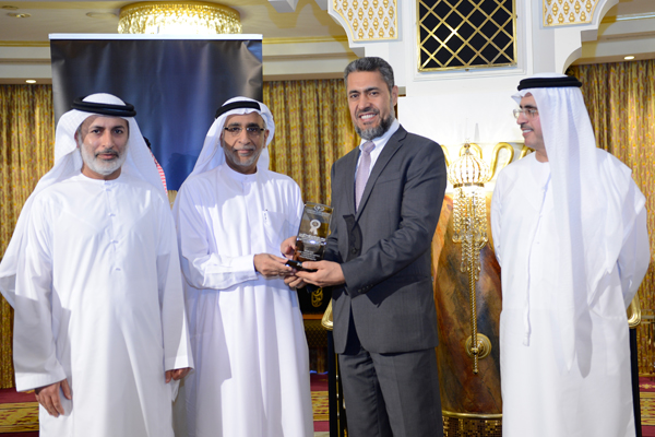 Mr. Sayed Aqa, UNDP's UAE Resident Representative presenting the Middle East Public Facilities Management Excellence Award to  H.E  Mohammed Julfar, Assistant Director General - Corporate Support  Dubai Municipality