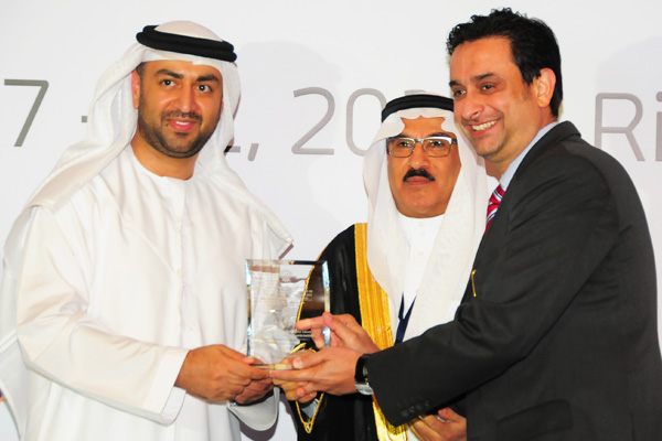 H.E Dr. Eng Ali Mohammad Al-Khouri, Director General of the Emirates Identity Authority (Left) and H.E. Dr. Fahad bin Matad Al-Hamad, Assistant Chairman of the Shura Council (Middle) presenting the eBanking Excellence Award to the Dubai Islamic Bank