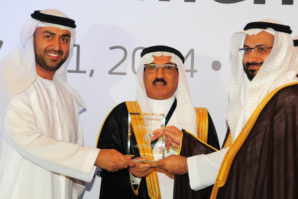 H.E Dr. Eng Ali Mohammad Al-Khouri, Director General of the Emirates Identity Authority (Left) and H.E. Dr. Fahad bin Matad Al-Hamad, Assistant Chairman of the Shura Council (Middle) presenting the eInitiative Excellence Award to the Ministry Of Justice - UAE