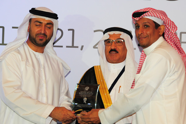 H.E Dr. Eng Ali Mohammad Al-Khouri, Director General of the Emirates Identity Authority (Left) and H.E. Dr. Fahad bin Matad Al-Hamad, Assistant Chairman of the Shura Council (Middle) presenting the eInitiative Excellence Award to the Saudi Post - KSA