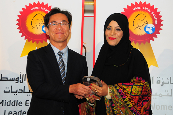 Hon. Japanese Consul General Hisashi Michigami Presents the Woman Leader in Education Development Excellence Award to Mrs. Afra Saif Obaid Bu Samnoh, Assistant Director of Training and Development - Ministry of Education, UAE