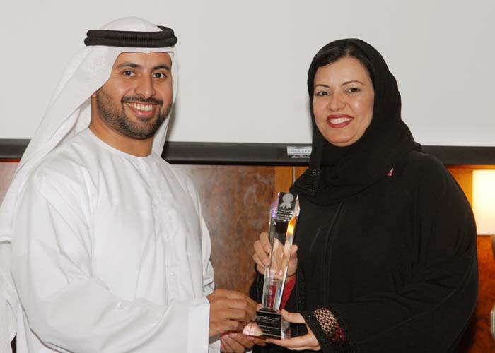 Dr .Aysha Busmait, Director of Marketing & Corporate Communication Department  RTA receives Public Transport Customer Care Excellence Award from Sheikh Maktoum Bin Hasher Al Maktoum, CEO, Al Fajer Group