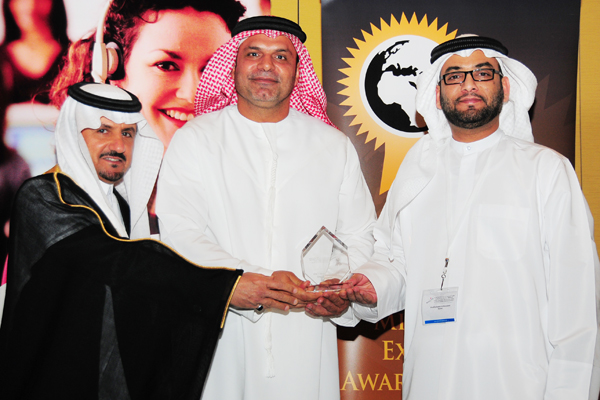 Mr. Ali Al Ahmed, Chief Corporate Communications Officer - UAE Etisalat, Receives the Telecom Customer Care Excellence Award, Presented by The Chief Guest H.E Khalifa Salem Al Mansoori Executive Director, Area Services Sector, Madinat Zayed of the Western