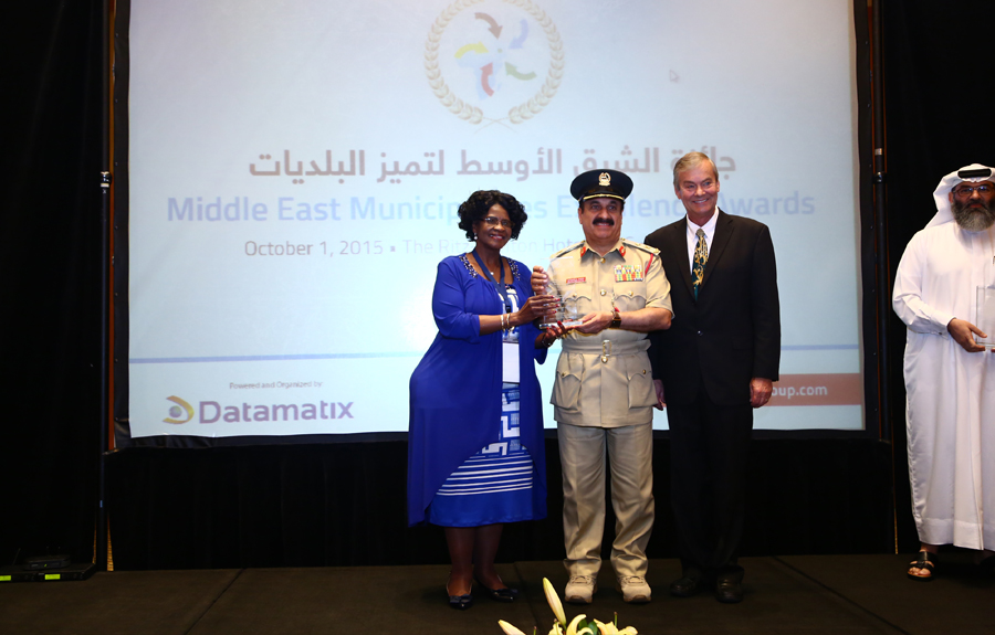 Dubai Police Force Awarded the 'Secure Cities Development Initiatives Excellence Award': H.E Major-General Abdul-Rahman Mohammad Rafi, Deputy Commanding General for community service and equipment receiving the Award from Mr. Brad Woodside, Mayor of Fredericton, Canada and Mrs. Sarah Matawana Mlamleli, Member Executive Council, Department of Corporative Governance and Traditional Affairs, Free State Provincial Government of South Africa