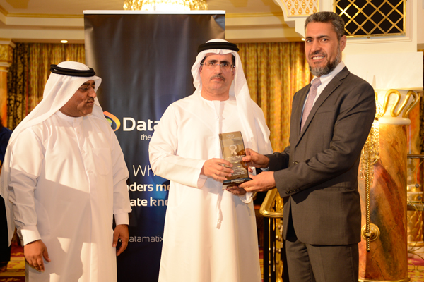 Mr. Sayed Aqa, UNDP's UAE Resident Representative presenting the Utilities Usage and Management Excellence Award )  (DEWA ) to H.E. Saeed Mohammed Al Tayer MD & CEO