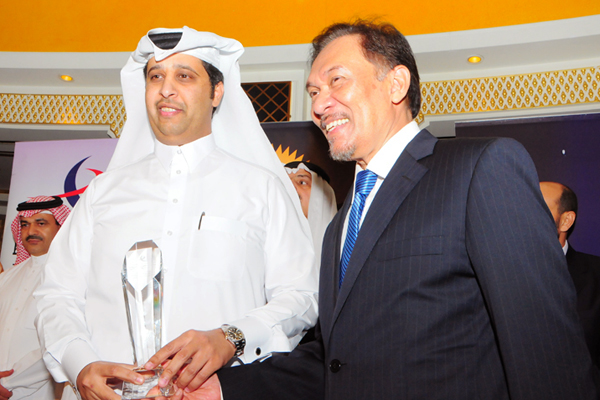 Mr. Ali Shareef Al-Emadi Group CEO Qatar National Bank, awarded Banking and Finance CEO Excellence Award, received by Mr. Salem Al-Naimi Assistant General Manager, Corporate Relations on his behalf,presented by chief guest Hon. Dato Seri Anwar Ibrahim
