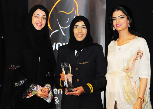 Salma Al Beloushi, Etihad Airways, Awarded Woman Pilot Excellence Award with H.H Princess Ameerah Al Taweel (Right) and H.E. Reem Al-Hashimy U.A.E. Minister of State (Left).