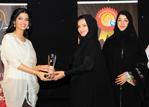 Dr.Asmae El Koutbi, UAE President of UAE Geography Association, Awarded Woman in Knowledge Management Excellence Award. Award Presented by H.H Princess Ameerah Al Taweel  (Left) with H.E. Reem Al-Hashimy U.A.E. Minister of State (Right).