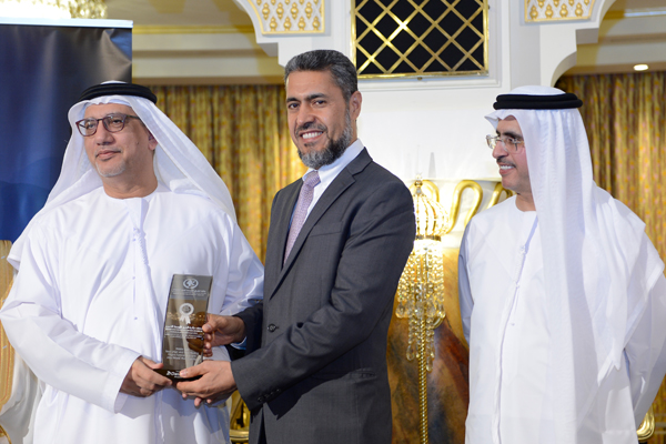 Mr. Sayed Aqa, UNDP's UAE Resident Representative presenting the Middle East New Urban and New Housing Project Excellence Award to Mr.Adel Al Rabia - Marketing and Corporate Communications Director