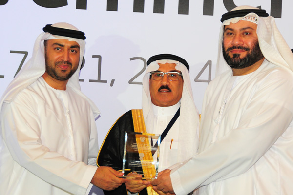 H.E Dr. Eng Ali Mohammad Al-Khouri, Director General of the Emirates Identity Authority (Left) and H.E. Dr. Fahad bin Matad Al-Hamad, Assistant Chairman of the Shura Council (Middle) presenting the eCourt excellence Award to the Ministry of Justice - KSA