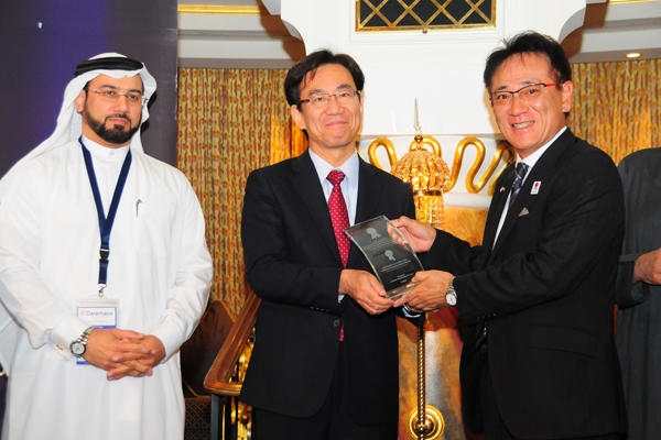 H.E. Hisashi Michigami, Consul General of Japan in Dubai, presenting the ICT Development Customer Care Excellence Award To Mr. Soichi Murakami,Managing Director - Brother International (Gulf) FZE