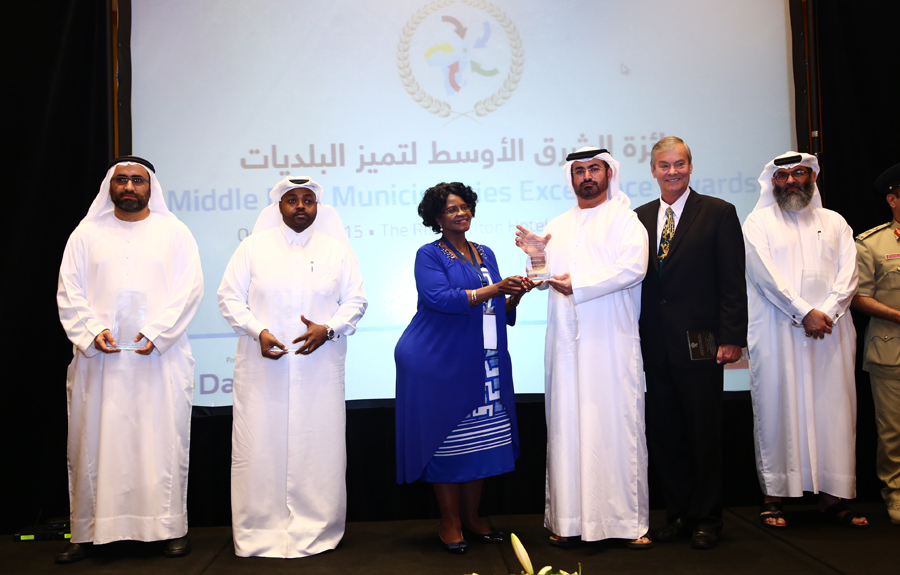 Al Ain Municipality Awarded the 'Development of Green Cities Excellence Award': Eng. Mohammed Thani Al Muhairi, Director of Parks Department receiving the Award from Mr. Brad Woodside, Mayor of Fredericton, Canada and Mrs. Sarah Matawana Mlamleli, Member Executive Council, Department of Corporative Governance and Traditional Affairs, Free State Provincial Government of South Africa